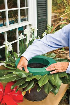 Steps to Making the Perfect Wreath - How To Make a Magnolia Wreath - Southernliving. Start with a 15-inch florist foam wreath that has been soaked in water. Note: Dave prefers the OASIS brand. 	Set the form atop an empty 3-gallon nursery pot. The groove on the bottom of the form fits perfectly on the pot, keeping it stable.