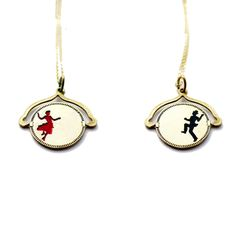 If you spin this necklace quickly, it looks like the man and woman are dancing