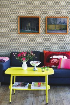 deep blue & pink & a limey-yellow, with patterned wallpaper.