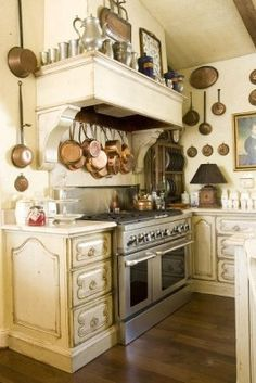 Country French kitchen, Like how the walls are used for storage. A bit much for my taste but like it