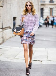 A geometric, collared top is paired  with a contrasting patterned skirt