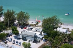 "With a cold drink in hand, pick your spot on Captiva Beach and look for the ""green flash"" at sunset."