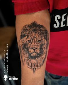 Lion Tattoo for men on arm at Aliens Tattoo India. Visit the link given below to see our more Animal Tattoos. Lion Arm Tattoo, Crab Tattoo, Mens Lion Tattoo, Alien Tattoo, Tiger Tattoo, Father Daughter Tattoos, Tattoos For Daughters, Arm Tattoos For Guys, Creative Tattoos