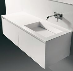 Corian counterstops, sometimes referred to as solid surface countertops, have a number of distinct advantages over ceramic tile or laminate countertops. Corian Countertops, Bathroom Countertops, Bathroom Cabinets, Bathroom Furniture, Modern Bathroom Design, Bathroom Interior Design, Lavabo Corian, Washbasin Design, Home Design
