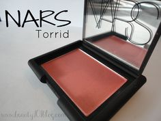 NARS Torrid. Perfect for olive to natural bronze tone skin. Absolutely love this one, made me ditch my Flirt brand blush after years of faithful use which has shimmer but not nearly this good. Torrid has a very fine shimmer to it without being glitter face overload which is perfect.