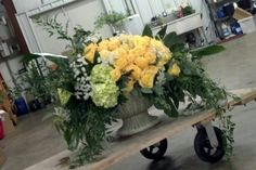 50 Skyline roses, green hydrangea, Queen Anne's lace, seeded euc., ruscus, & mixed tropical leaves......50th Wedding Anniversary Church Arrangement, designed by Sonya Archer