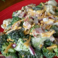 This is kind of like what I make. I have my own recipe for this,  too. Just making a list for turkey day.   Broccoli and Cauliflower Salad
