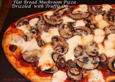 Flatbread Mushroom Pizza - Easy Life Meal & Party Planning - A scrumptious thin and crispy flat bread pizza loaded with baby bella mushrooms, fresh mozzarella pearls and drizzled with truffle oil.
