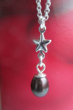 Silver star Black pearl drop necklace from Crimeajewel