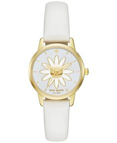 A cute daisy dial blends brilliantly with the soft white leather strap of this Mini Metro watch by kate spade new york. | White leather strap | Round gold-tone stainless steel case, 26mm | Cream mothe