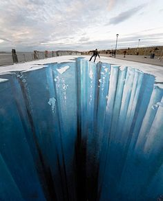 Some people are talented, others are just truly remarkable. German artist Edgar Muller makes these three-dimensional apocalyptic fantasy street art in cities across the world.