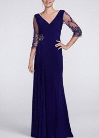 Absolutely breathtaking, this 3/4 sleeve V neck beaded dress has all the elements to make it truly one of a kind!  V-neck long jersey dress features beautifully designed sheer sleeve beaded detail.  Empire waist with sparkling brooch accent helps create a stunning silhouette.  Side draping creates dimension and elongates figure.  3/4 sleeve provides just the right amount of coverage.  Fully lined. Side zip. Imported polyester. Dry clean.