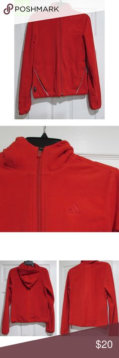 """Adidas Red Fleece Climawarm Hoodie w/ Thumbholes! This might look like a basic red hoodie, but it's packed with cool features to keep you stylish and comfy while you stay warm: --2 zippered pockets --Thumbholes on sleeves --""""Embossed"""" Adidas stripes down back --Climawarm technology  100% polyester.   Medium, but a bit small. Approx. measurements provided in photo.   Good preloved condition with some signs of wear. There are a couple of tiny, tiny marks. For example, one is near the left…"""