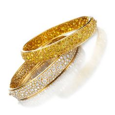 A Pair of Diamond and Colored Diamond Bangles, by Van Cleef & Arpels. FD Gallery. (=)