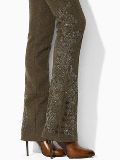 Chocolate/Olive shade of beaded, studded with brads, & embroidery stitched wool pant with design focusing on the lower, out-facing side of the leg down to the button open/or closed boot cut detail finish.
