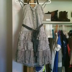 Gray dress Wore it for hoemcoming one year and never again. It has the halter straps to tie it up but that is it. Its very soft and easy to move in. Not that short but above the knee still. Has a flower design through the whole dress. Dresses