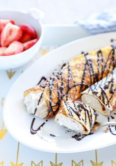 Keto Cannoli Stuffed Crepes - cut up and on a fork