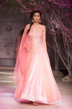 Pink princess ballroom tulle lehnga dress by Jyotsna Tiwari. More here: http://www.indianweddingsite.com/bmw-india-bridal-fashion-week-ibfw-2014-jyotsna-tiwari/