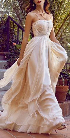 Blush cascading gown jαɢlαdy in a different shade and with no straps it could be a beach wedding dress.?