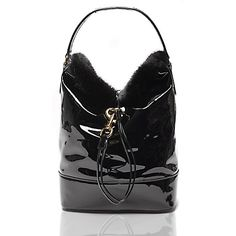 Tommy Hilfiger women's bag.  Hilfiger Collection, Fall 2015. Crafted from patent leather and luxuriously lined with faux fur, this statement bag adds instant polish. Inside, a sleek matching wristlet to act as a wallet, or worn alone should you prefer to travel light. <br>• Bucket silhouette in patent leather with gold-tone hardware.<br>• 14'' (H) 10'' (L) 6.5'' (W) 5'' drop.<br>• Drawcord closure, lined, coordinating wristlet included.<br>• Leather cleaner only.<br>• Imported.<br>