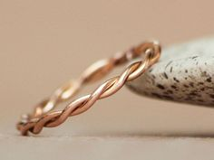 Delicate 14 Karat Rose Gold Twisted Wedding by moonkistdesigns