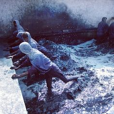 """Check out this amazing image from Industry Of All Nations. These workers in the south east of India have been doing this 100% organic real indigo process for more than 1500 years, and Juan & Fernando from IOAN have developed a bond with them, living with them for months at a time to develop their """"Clean Clothes Project"""" in a sustainable way with the craftsman that invented this hand done process… cleaner clothes against our skin, but also cleaner rivers, oceans, soil and air for everybody."""