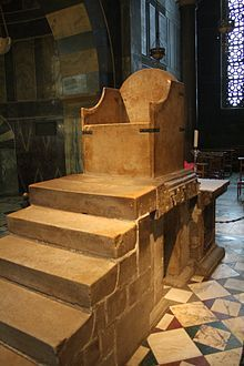 Throne of Charlemagne and the subsequent German Kings in Aachen Cathedral - compare the simplicity of the throne with the jewelled crown.