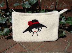 Mother's Day Giveaway, felted knit and needle felted makeup/fashion bag USA only  http://felting.craftgossip.com/giveaway/mothers-day-giveaway-felted-knit-and-needle-felted-makeupfashion-bag-usa-only/