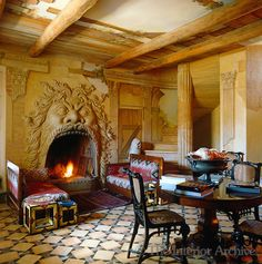Trompe l'oeil ruins cover the walls of this unusual living room which features a fireplace shaped as the mouth of Neptune and a patterned marble floor in Tuscany ~ Renzo Mongiardino