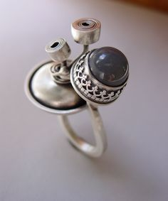 Ring | Reagan Hayhurst.  Moonstone and sterling silver ... I partcularly like the metal coils