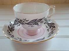 Black and Pink tea cup
