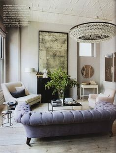 heavenly - lavender linen upholstered chesterfield and antiqued mirorr and Ochre chandelier