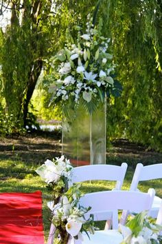 Beautiful outdoor ceremony with the lake and Willow tree as the backdrop at a gorgeous winery. Colour theme of white, green and natural brown to compliment.