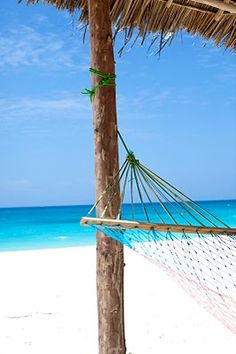 Zanzibar - Africa. The whitest sand and clearest water I've ever seen! This place is absolutely amazing!
