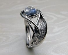 Contemporary, Art Nouveau style engagement ring, with blue moonstone.