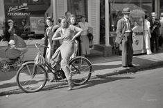 """Summer 1937. """"Street scene -- Provincetown, Massachusetts."""" And a reminder to """"Don't write -- Telegraph!"""" 35mm negative by Edwin Rosskam."""
