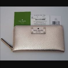 NWT Kate Spade wallet Brand new beautiful Kate Spade wallet in rose gold. New with tags and never used. This is a limited color! Make me an offer! kate spade Bags Wallets
