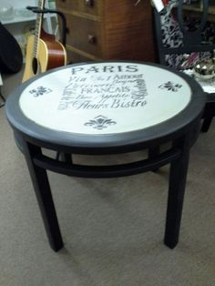$69 - This vintage table has been painted black, the top is painted gray with black stenciling. It measures 26 inches in diameter and stands 22 inches tall. It can be seen in booth D6 at Main Street Antique Mall 7260 East Main St ( E of Power Rd ) Mesa 85207  480 9241122open 7 days 10 till 530 Cash or charge accepted