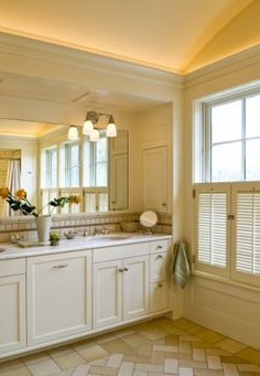 Tray ceiling with overhead trim and recessed master vanity. LOVE.