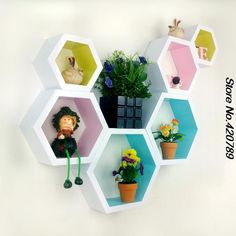 The best 25 DIY honeycomb shelf projects for your home. Give your space a fresh look with these simple DIY craft ideas that is easy to make below. The best honeycomb shelf projects for your bedroom, living room, or nursery. Hexagon Wall Shelf, Honeycomb Shelves, Cube Mural, Decorative Wall Panels, Decorative Shelf, Diy Room Decor, Wall Decor, Wall Hanging Crafts, Decorating Bookshelves