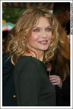 Details:  Hair Style: This is a cute hairstyle as Michelle Pfeiffer has her hair long and curly. There is lots of volume to the hair as the curls fall full onto the back. The overall look for this style is chic and classy.  Hair Cut: This haircut is long.  Hair Colour: The hair colour is dark blonde.  Suitable For:  Face shapes: oval, square, heart, diamond  Hair texture: medium  Hair density: medium  Styling:  Techniques: blow dry, scrunch  Products: mousse, hair spray, curl enhancer…