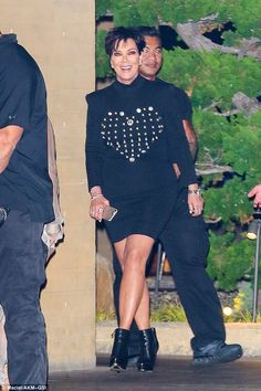 All better: Kris Jenner added a pair of heeled ankle boots and plenty of glittering jewell...