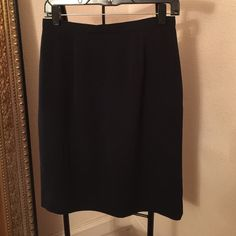 JH COLLECTIBLES SKIRT + VEST JH COLLECTIBLES  navy skirt and matching vest lost in closet never worn. In new condition. JH COLLECTIBLES Skirts Midi