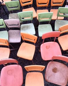 Rustic pastel chairs from an old school room. Gimme some of these!