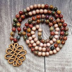 This mala is probably my favorite out of the Earth Collection! Isn't this wooden Celtic knot pendant gorgeous? Celtic Knot, Ornament Wreath, Knots, Lime, Beaded Bracelets, Photo And Video, My Favorite Things, Pendant, Earth