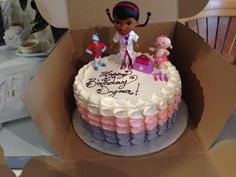 Doc character birthday cake. Petal pull buttercream in pink and purple. White Rock BC Nut-free Bakery