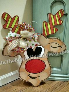 Reindeer Christmas Wooden Door Hanger by OnTheBrightSideArt on Etsy https://www.etsy.com/listing/251864538/reindeer-christmas-wooden-door-hanger