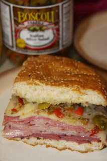 Different olive salad with more veggies. One of my favorite sandwiches! New Orleans Muffuletta Sandwich with Olive Salad Muffuletta Sandwich, Salad Sandwich, Soup And Sandwich, Vegetarian Sandwiches, Muffaletta Olive Salad Recipe, Po Boy Sandwich, Club Sandwich Recipes, Panini Recipes, Cuban Sandwich