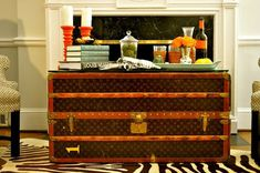 Steamer trunks to add storage and a unique surface combined with other fun patterns (zebra etc.) creates a warm and chic space!