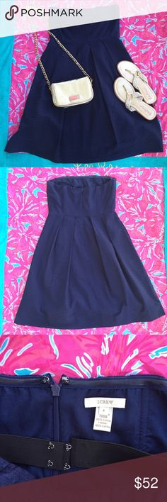 J. Crew Navy Solid Embossed Lorelei dress Size 4 J. Crew Solid embossed Lorelei dress in Navy - Size 4 EUC  The perfect little dress for sun-filled days, on or off the beach. A perfect addition to your preppy closet! Dressed in beautifully textured cotton in a sweetly ruched strapless silhouette. Fitted bodice, with boning for added support and elastic along the top edge and a clasped elastic band beneath the bust to hold it up—so you won't have to. •A-line silhouette •Cotton •Falls above…
